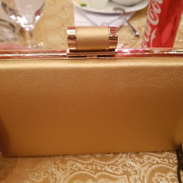 Gold formal bag