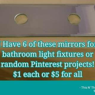 Mirrors for bathroom light fixtures