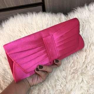 Pink clutch for formal wear