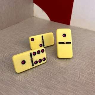 Domino rings