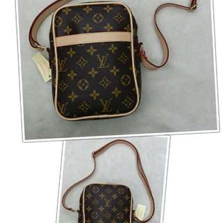Lv sling bag c/w paper bag & receipt