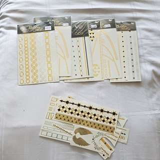 Temporary  Gold Tattoos - 6 packets unopened plus a bundle opened.