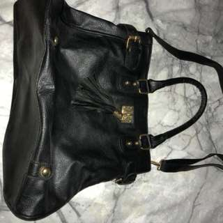Black bag with tassel