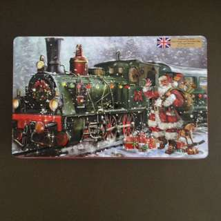 Britannica: Grandma Wilds Embossed Santa Train Tin