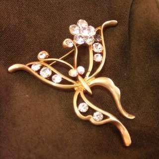 Golden butterfly brooch
