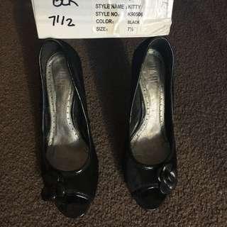 Size 7.5 black faux fur heels