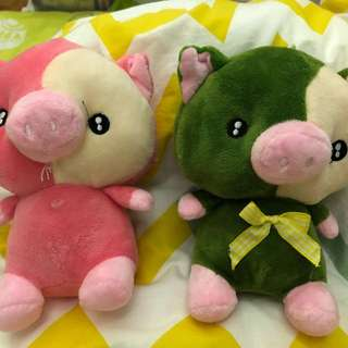 Two piglets stuffed toys