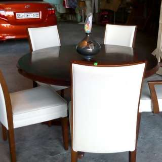 Round table with five chairs
