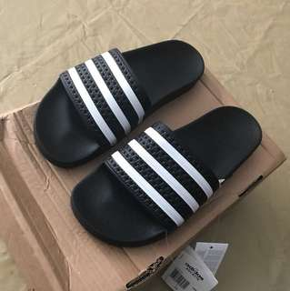 Brand new adidas slides for women, never worn tag still on them ! Size 7