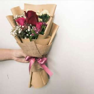 Fresh red roses with other flower