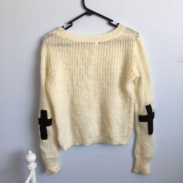 White knit jumper with cross at elbows
