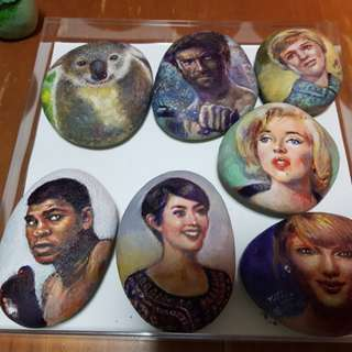 Hand painted portraits on pebbles
