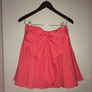 Coral skater skirt with cute bow on front