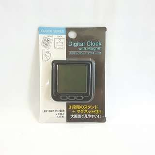Digital clock with magnet