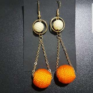 Orange and off white earrings