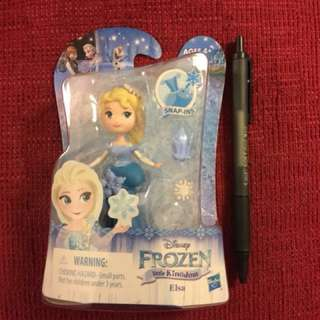 Type 1 small Frozen Elsa doll with snap-on accessories