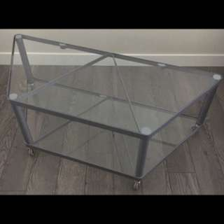 Glass tv stand on wheels