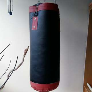 Punching bag with hanging chain.