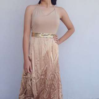 Nude halter formal gown with gold sequin detail