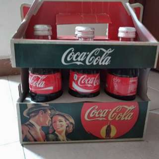 Coca Cola bottles in carton box