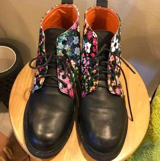 Lightly worn boots with floral prints