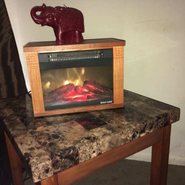 Fireplace with flame effect. In perfect condition. Willing to change the price.