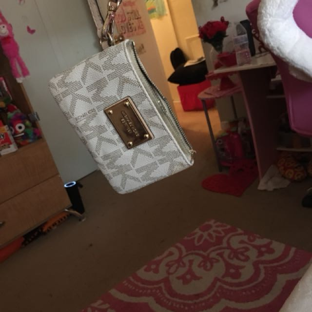 Micheal Kors wristlet. Willing to change the price.