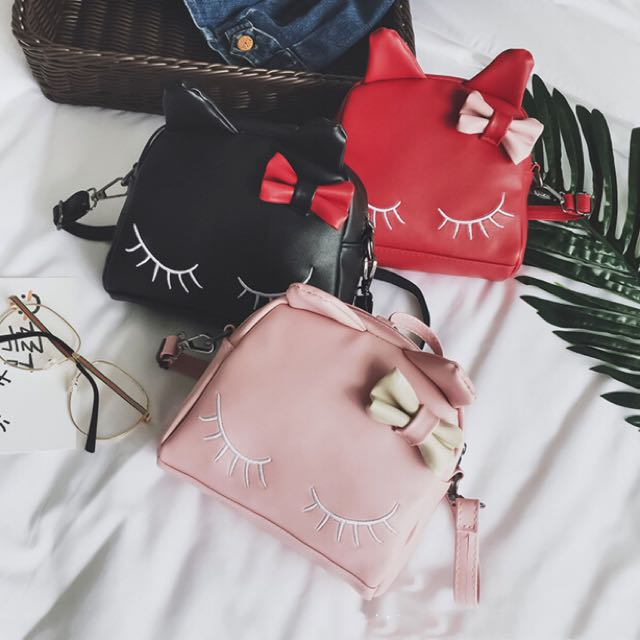 Red convertible sling backpack kid bag