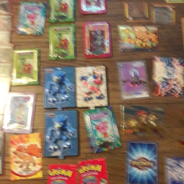 Yugeo, Pokemon, digimon, circa1982, trading cards, all protected, about 75 cards