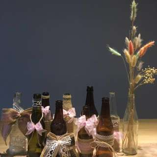 Assorted glass bottles with burlap ribbons