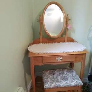 Vanity with mirror.