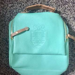 Turquoise colored handbag 👜