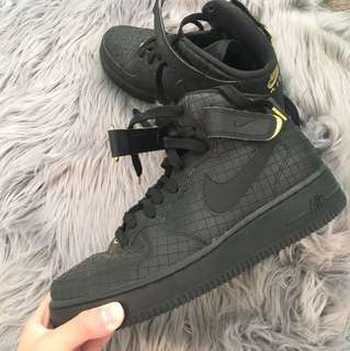 Nike Air Force black and gold