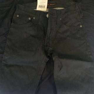 Nudie skinny jeans in dry coated Black
