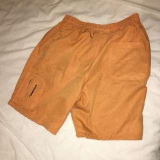 Reebok orange workout sports shorts
