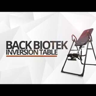 Inversions gravity table relives back pain .