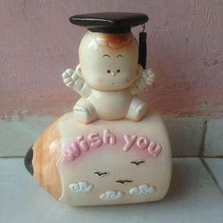 Celengan Porselin Bentuk Pencil dan bayi dengan topi wisuda
