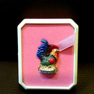 Wealth fetching rooster with gold takrut.