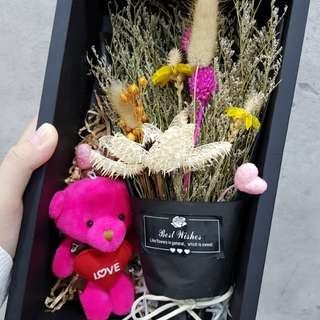 Gift box with dried flowers bouquet