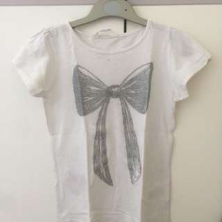 White tops with ribbon