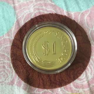 $1 lion head coin..
