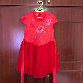 Girl's red cheongsam