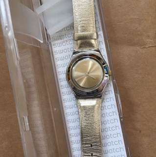 Gold swatch watch