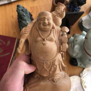 Antique wood laughing Buddha