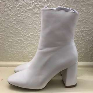 White leather heeled boots