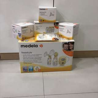 Medela Freestyle Breastpump with Extra Pump Parts!