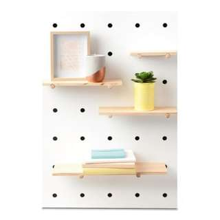 Peg board with wooden pegs