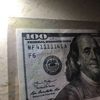 1/1111111机率(0.00009%) 全新100美金 背后竟然都是号码41!