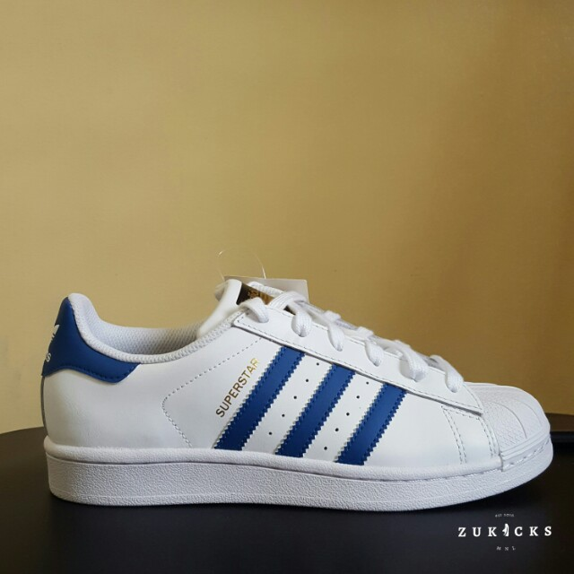 adidas superstar with blue stripes