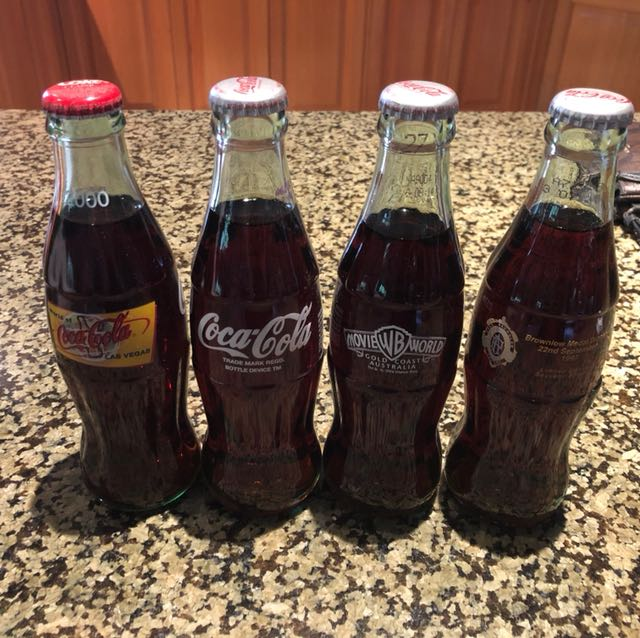 Collectable limited edition glass Coca Cola bottles